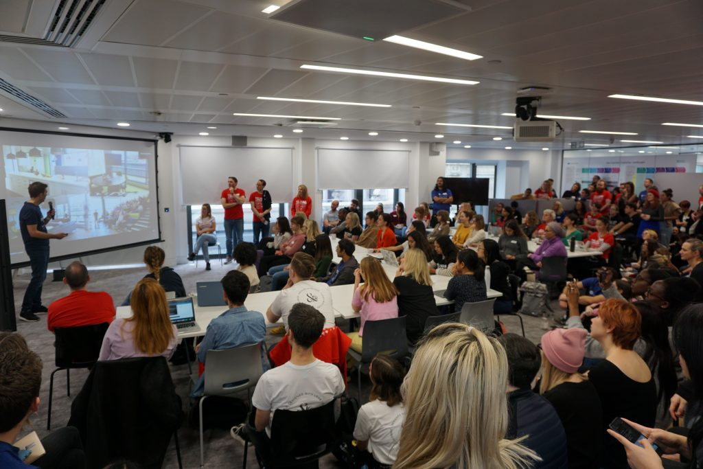 Olly presenting to a room full of people at Rails Girls London